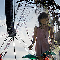 LIVERPOOL, UK, 20th April, 2012. The Sea Odyssey. The little girl giant showers after waking up.