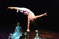 © London News PIctures. Hand Balancing; Denys Tolstov at Cirque Du Soleil Alegria opening night, O² Arena, London UK, 18 July 2013. Photo credit: Richard Goldschmidt/LNP