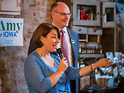 18 OCTOBER 2019 - SIGOURNEY, IOWA: US Senator AMY KLOBUCHAR (D-MN) talks to Iowans at a campaign stop in Sigourney, IA, while her husband, JOHN BESSLER, stands behind her. Sen. Klobuchar is on barnstorming bus tour of southeast Iowa this weekend. She is campaigning to be the Democratic nominee for the US Presidency. In addition to campaign meet and greet events, she stopped at a biofuels plant to learn about the difficulties farmers and biofuels producers face because of the trade war with China. Iowa holds the first selection event of the Presidential election cycle. The Iowa caucuses are Feb. 3, 2020.        PHOTO BY JACK KURTZ