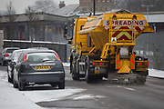 A Lambeth council gritting lorry spreads grit over a minor road by Herne Hill station in south London during the bad weather covering every part of the UK and known as the 'Beast from the East' because Siberian winds and very low temperatures have blown across western Europe from Russia, on 1st March 2018, in Lambeth, London, England