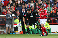 Photo: Pete Lorence.<br />Nottingham Forest v Scunthorpe United. Coca Cola League 1. 07/10/2006.<br />Scunthorpe's Steve Foster and Grant Holt tussle for the ball.