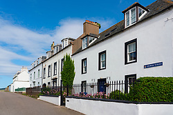 Whitewashed terraced houses in Cromarty village on Black Isle on Cromarty Firth, Ross and Cromarty, Scotland, UK
