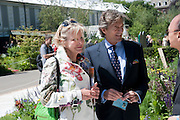 Nigel Havers; Georgiana Bronfman, PRESS PREVIEW. The RHS Chelsea Flower Show 2011. The Royal Hospital grounds. Chelsea. London. 23 May 2011. <br /> <br />  , -DO NOT ARCHIVE-© Copyright Photograph by Dafydd Jones. 248 Clapham Rd. London SW9 0PZ. Tel 0207 820 0771. www.dafjones.com.