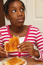 Girl eating toast