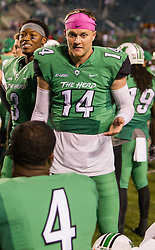 Oct 9, 2015; Huntington, WV, USA; Marshall Thundering Herd quarterback Chase Litton talks with Marshall Thundering Herd wide receiver Deon-Tay McManus  during the fourth quarter against the Southern Miss Golden Eagles at Joan C. Edwards Stadium. Mandatory Credit: Ben Queen-USA TODAY Sports