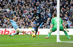 Tottenham Hotspur's Emmanuel Adebayor takes a shot at goal. - Photo mandatory by-line: Dougie Allward/JMP - Tel: Mobile: 07966 386802 24/11/2013 - SPORT - Football - Manchester - Etihad Stadium - Manchester City v Tottenham Hotspur - Barclays Premier League