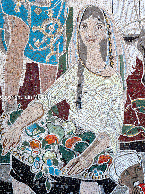 Detail of communist era mosaic of people from foreign countries on wall of Cafe Moskau on Karl Marx Allee in former East Berlin Germany