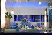 interior of a hair saloon with an woman sitting in a chair