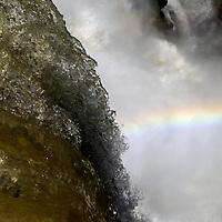 South America, Argentina, Iguacu Falls. Rainbow in the Falls.