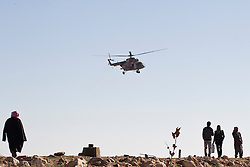 © Licensed to London News Pictures. 11/12/2014. Sinjar Mountains, Iraq. An Iraqi Air Force Mi-17 Hip helicopter comes in for a supply run on the top of Mount Sinjar.<br /> <br /> Although a well publicised exodus of Yazidi refugees took place from Mount Sinjar in August 2014 many still remain on top of the 75 km long ridge-line, with estimates varying from 2000-8000 people, after a corridor kept open by Syrian-Kurdish YPG fighters collapsed during an Islamic State offensive. The mountain is now surrounded on all sides with winter closing in, the only chance of escape or supply being by Iraqi Air Force helicopters. Photo credit: Matt Cetti-Roberts/LNP