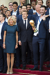 French President Emmanuel Macron, his wife Brigitte Macron, head coach Didier Deschamps and captain and goalkeeper Hugo Lloris, holding the trophy, pose among teammates during a reception at the Elysee Presidential Palace on July 16, 2018 in Paris, France, after French players won the Russia 2018 World Cup final football match. France celebrated their second World Cup win 20 years after their maiden triumph on July 15, 2018, overcoming a passionate Croatia side 4-2 in one of the most gripping finals in recent history. Photo by Eliot Blondet/ABACAPRESS.COM