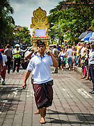 16 JULY 2016 - UBUD, BALI, INDONESIA: Men carry the litter that will the effigy of a person cremated in the mass cremation in Ubud Saturday. Local people in Ubud exhumed the remains of family members and burned their remains in a mass cremation ceremony Wednesday. Almost 100 people were cremated and laid to rest in the largest mass cremation in Bali in years this week. Most of the people on Bali are Hindus. Traditional cremations in Bali are very expensive, so communities usually hold one mass cremation approximately every five years. The cremation in Ubud concluded Saturday, with a large community ceremony.     PHOTO BY JACK KURTZ