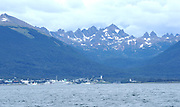 Cruise ships moored on the docks of Puerto Williamson on Navarino Island in the Beagle Channel,  Tierra del Fuego, Chile