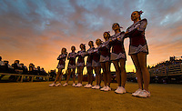 As the sun set, the Bear River Bruin's cheerleaders watch the Senior night ceremony as the Bear River Bruins host the Placer Hillman, Friday October 23, 2015.<br /> Brian Baer/Special to the Bee