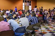 """18 AUGUST 2012 - PHOENIX, AZ:  People at the deferred action workshop at Neighborhood Ministries in Phoenix. More than 1000 people attended a series of 90 minute workshops in Phoenix Saturday on the """"deferred action"""" announced by President Obama in June. Under the plan, young people brought to the US without papers, would under certain circumstances, not be subject to deportation. The plan mirrors some aspects the DREAM Act (acronym for Development, Relief, and Education for Alien Minors), that immigration advocates have sought for years. The workshops were sponsored by No DREAM Deferred Coalition. PHOTO BY JACK KURTZ"""