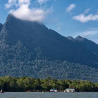 Sarawak River and Gunung Santubong with clouds covering it's peak.