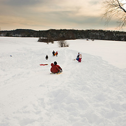 Young boys (age 5) sledding at Wagon Hill Farm in Durham, New Hampshire.