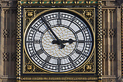 A detail of Big Ben's clock face in Westminster, central London. The clock and dials were designed by Augustus Pugin, set in an iron frame 23 feet (7.0 m) in diameter, supporting 312 pieces of opal glass, rather like a stained-glass window. As a symbol of parliamentary power and a national democracy, Big Ben is part of the Houses of Parliament or Westminster Palace, where the two Houses of the Parliament of the United Kingdom (the House of Lords and the House of Commons) conduct their business. It is therefore a potent symbol for British Governmental power, influence and a world-famous landmark for tourists. Big Ben is the name of the clock's bell and not the tower itself.