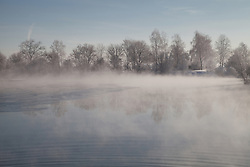 Fog over lake in winter, Eichenau, F¸rstenfeldbruck, Bavaria, Germany