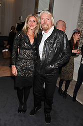 HOLLY ANDREWS and her father SIR RICHARD BRANSON at a party to celebrate the publication of Mum's The Word by Eve Branson held at Grace, West Halkin Street, London on 11th March 2013.