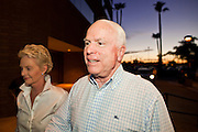 Aug. 23, PHOENIX, AZ: US Senator JOHN McCAIN, accompanied by his wife, CINDY McCAIN, walks into a campaign rally at his Phoenix, AZ, campaign office Monday. US Sen. John McCain held the final of his primary election campaign at his campaign offices in Phoenix Monday. McCain, Arizona's senior Republican US Senator, is facing former Congressman JD Hayworth in the primary, Tuesday, Aug. 24. McCain has outspent Hayworth by a considerable margin and is expected to win.   Photo by Jack Kurtz