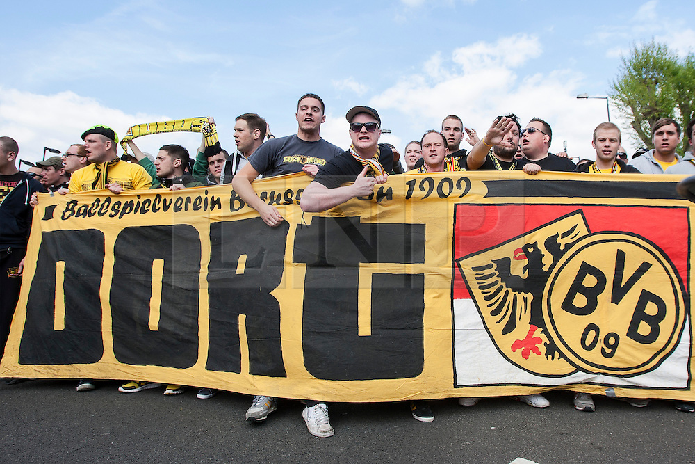 © licensed to London News Pictures. London, UK 25/05/2013. German football fans of Borussia Dortmund marching to Webley Stadium after clashes with Bayern Munich fans reported at Wembley Stadium ahead of Champions League final in London. Photo credit: Tolga Akmen/LNP