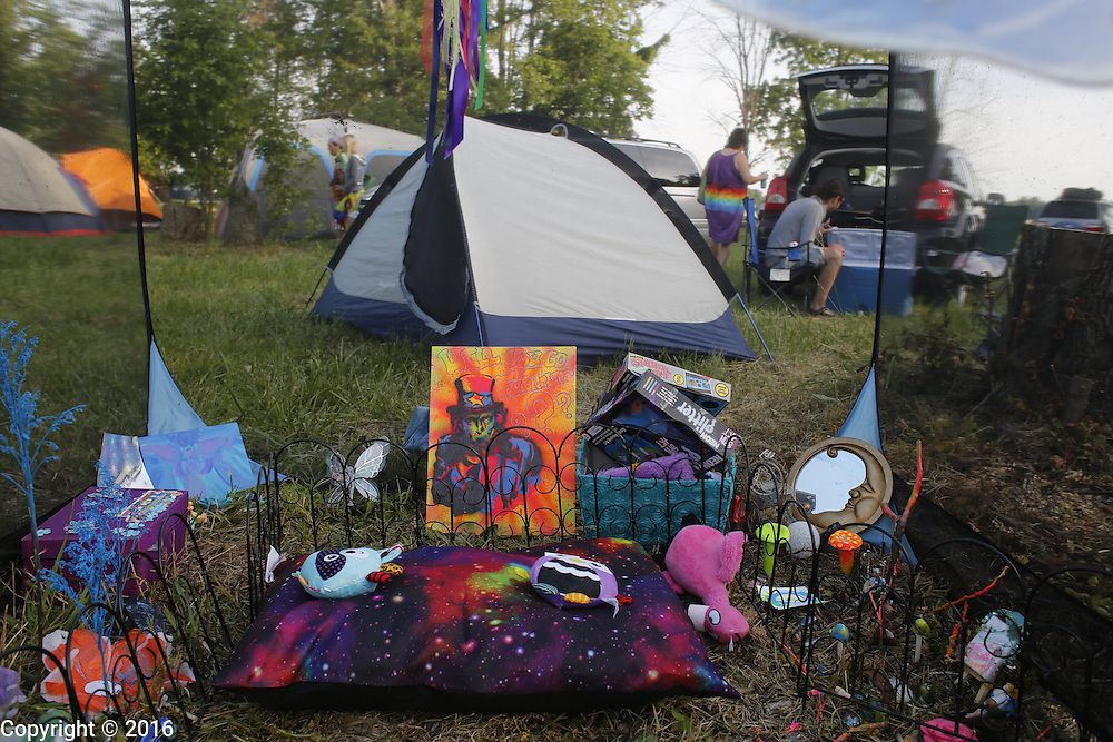 06212016 - Noblesville, Indiana, USA: A shrine sits under a tent at Backstage Campground near Klipsch Music Center (Deer Creek) after members of the Grateful Dead performed as Dead and Company. The Grateful Dead's final show at  Deer Creek in July 1995 was marred by over a thousand fans crashing the gates leading to the next day's show being canceled. Grateful Dead guitarist Jerry Garcia died a few weeks later. (Jeremy Hogan/Polaris)