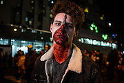 New York, NY - 31 October 2016. A man with a zipper on his face, the zipper opened to reveal bloody flesh under the skin.