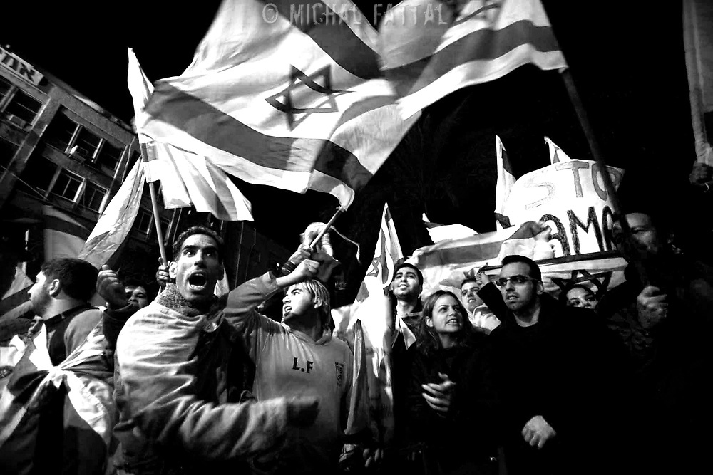 Likud supporters wave Israeli flags during a demonstration in Tel Aviv, January 2008.