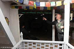 Scotty Busch on a chai break at the Buddha Pub and Bar in Marpha on day-5  of our Himalayan Heroes adventure riding from Kalopani through the Mustang District to our highest elevation of the trip at over 12,000' when we reached Muktinath, Nepal. Saturday, November 10, 2018. Photography ©2018 Michael Lichter.