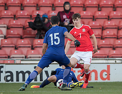 WREXHAM, WALES - Thursday, November 10, 2016: Wales' Benjamin Woodburn in action against Dimitris Nikolaou Greece during the UEFA European Under-19 Championship Qualifying Round Group 6 match at the Racecourse Ground. (Pic by Gavin Trafford/Propaganda)