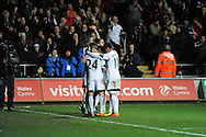Swansea City players celebrate Jonjo Shelvey's second half goal.<br /> Barclays Premier League match, Swansea city v Newcastle Utd at the Liberty stadium in Swansea, South Wales on Wednesday 4th Dec 2013. pic by Phil Rees, Andrew Orchard sports photography,