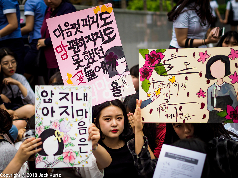 """SEOUL, SOUTH KOREA: South Korean women hold up placards during the Wednesday protest at the Japanese embassy in Seoul. The Wednesday protests have been taking place since January 1992. Protesters want the Japanese government to apologize for the forced sexual enslavement of up to 400,000 Asian women during World War II. The women, euphemistically called """"Comfort Women"""" were drawn from territories Japan conquered during the war and many came from Korea, which was a Japanese colony in the years before and during the war. The """"comfort women"""" issue is still a source of anger of many people in northeast Asian areas like South Korea, Manchuria and some parts of China.       PHOTO BY JACK KURTZ   <br /> Wednesday Demonstration demanding Japan to redress the Comfort Women problems"""