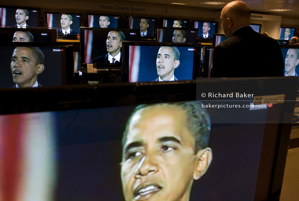 Barack Obama gives election victory speech on BBC News TV screens on audio floor of John Lewis department store