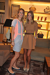 Left to right, sisters ADRIANA CHRYSSICOPOULOS and CAROLINA GONZALEZ-BUNSTER at a champagne breakfast hosted by Carolina Gonzalez-bunster and TOD's in aid of the Walkabout Foundation held at TOD's, 2-5 Old Bond Street, London on 9th May 2013.