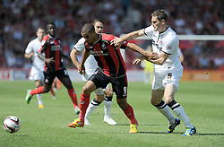 Bournemouth's Lewis Grabban takes the ball past Charlton Athletic's Dorian Dervite - Photo mandatory by-line: Alex James/JMP  - Tel: Mobile:07966 386802 03/08/2013 -Bournemouth vs Charlton Athletic  - SPORT - FOOTBALL -  Dean Court-Bournemouth - Charlton Athletic -