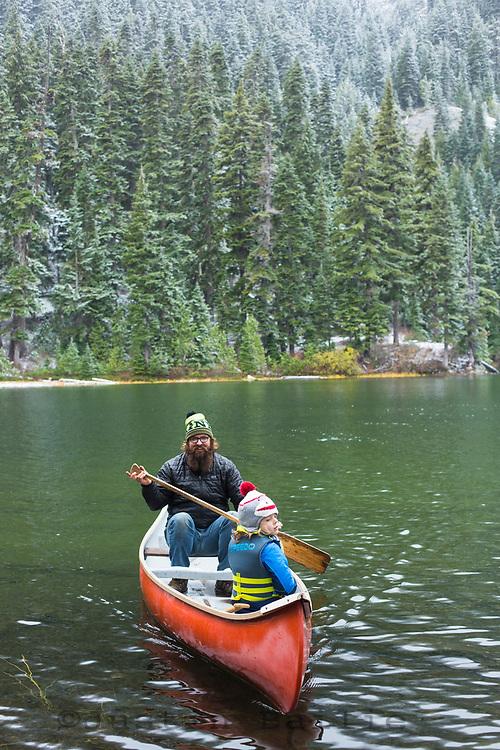 Canoeing on alpine lake near Mt Rainier National Park.