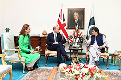 The Duke and Duchess of Cambridge talk with the Prime Minister of Pakistan Imran Khan during a visit to his official residence in Islamabad on the second day of the royal visit.