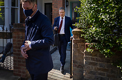 © Licensed to London News Pictures. 07/05/2021. London, UK. Labour Party Leader Sir Keir Starmer (R) leaves his house in north London with a close protection officer after it was announced that the Conservative Party have won the Hartlepool by-election. Local and mayoral elections have taken place in England, with National Assembly elections in Wales and Scotland. Results are expected over the weekend. Photo credit: Peter Macdiarmid/LNP