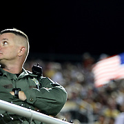 A security officer watches the 9/11 tribute to soldiers during an NCAA football game between the Boston College Eagles and the UCF Knights at Bright House Networks Stadium on Saturday, September 10, 2011 in Orlando, Florida. (AP Photo/Alex Menendez)