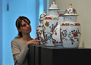 © Licensed to London News Pictures. 01/12/2011, London, UK. an immensely rare garniture of five Meissen Augustus Rex vases, also estimated to sell for £300,000-500,000. This is an five-vase garniture (set), comprising a central ovoid vase and cover, two smaller ovoid vases and covers and two bottle vases. It is likely that the five were originally part of a garniture of seven vases. Photo credit : Stephen Simpson/LNP