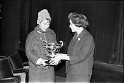 30/03/1963<br /> 03/30/1963<br /> 30 March 1963<br /> Schools Drama Festival at The Gate Theatre, Dublin.<br /> Picture shows Caitlin Bean Ui Neill, Chairman of Cumann Drámaíochta na Scoil ? (right presents the Girls Primary Schools under 8 trophy to Mrs Martin Turley  who accepted on behalf of Scoil Na Maighdine Mhuire, Cora Chaithlin, Co. Clare.