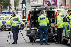 © Licensed to London News Pictures. 15/08/2018. London, UK. Police at the scene of an accident at Holborn where a cyclist has died after being hit by a lorry - believed to be former doctor to the Queen Peter Fisher. Photo credit: Rob Pinney/LNP