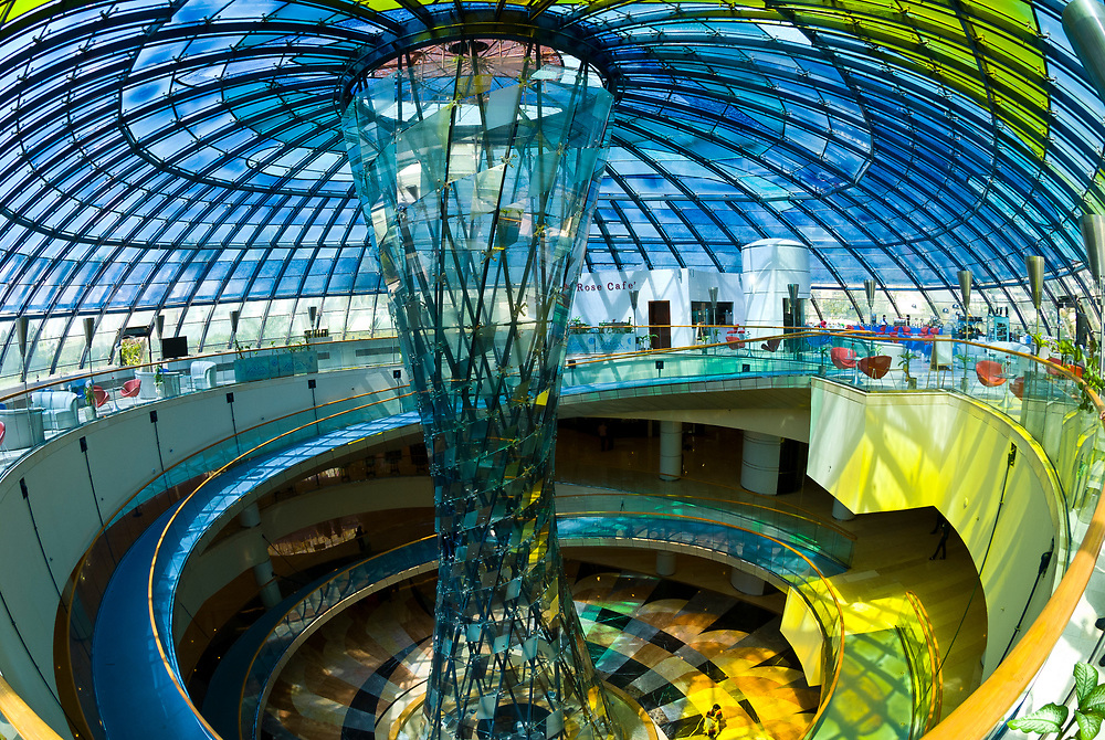 The Rose Cafe, at the top of an atrium with a glass sculpture in the center and topped by a stained glass dome, Wafi City Mall (an Egptian themed mall), Dubai, United Arab Emirates