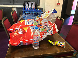 Supplies at the Maxilla social club at the at the foot of Grenfell Tower in west London which has been opened to give residents fleeing the fire at the tower block refuge.