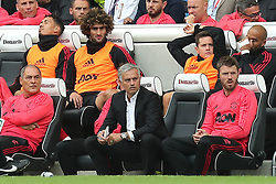 Manchester United's Chris Smalling (top row), Fellaini, Ander Herrera and Lee Grant alongside manager Jose Mourinho (bottom centre) and coach Michael Carrickon on the bench during the Premier League match at the AMEX Stadium, Brighton.