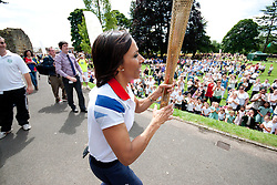 © London News Pictures. 17/07/2012. Tonbridge Castle, Tonbridge, Kent. Dame Kelly Holmes runs with the Olympic Torch in the gardens of Tonbridge Castle, Kent.  Photo credit should read Manu Paomeque/LNP.
