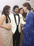 April 10, 2016 - Mumbai, INDIA - <br /> <br />  Kate, the Duchess of Cambridge, right, speaks with Bollywood stars Shah Rukh Khan, second left, and Aishwarya Rai, left as Bollywood star Madhuri Dixit watches during a charity ball at the Taj Mahal Palace hotel in Mumbai, India, Sunday, April 10, 2016. The royal couple began their weeklong visit to India and Bhutan, by laying a wreath at a memorial Sunday at Mumbai iconic Taj Mahal Palace hotel, where 31 victims of the 2008 Mumbai terrorist attacks were killed.<br /> ©Exclusivepix Media