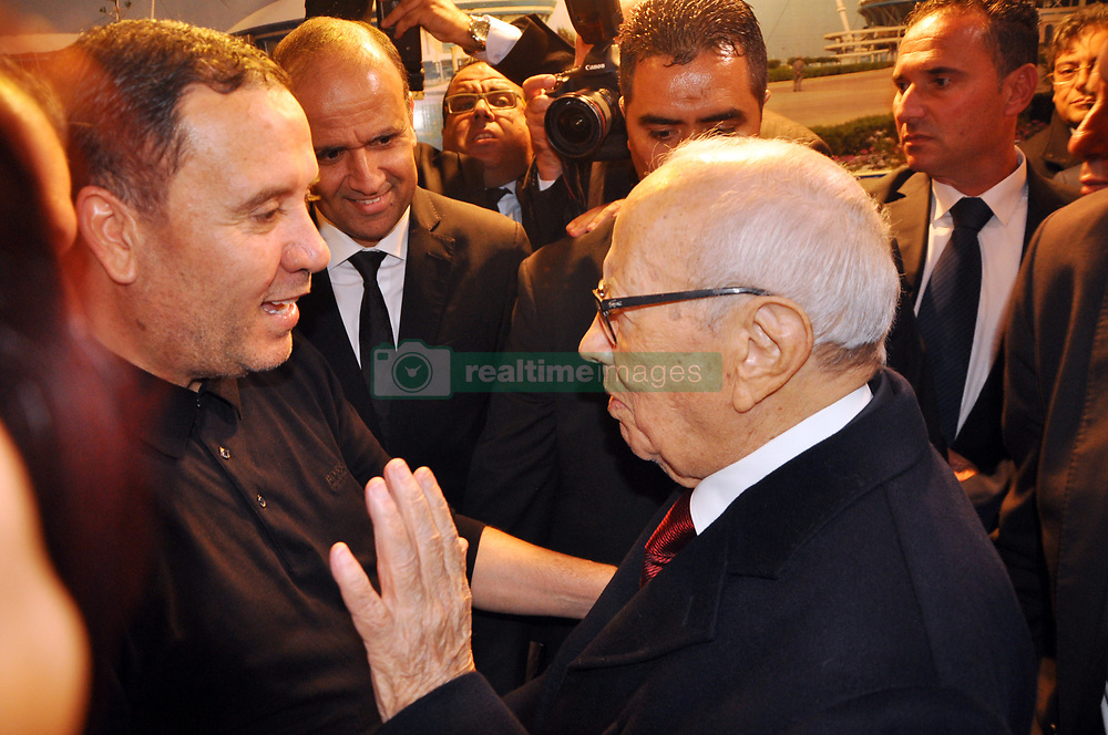 November 11, 2017 - Rades, Tunisia - The president of the republic Beji Caid Essebsi congratulates the coach of the Tunisian team Nabil Maaloul(L) in the locker room for the qualification to the Russian world ....Qualifying match for the 2018 FIFA Russia World Cup at Rades Stadium between Tunisia and Libya..Tunisia qualifies for the Russian world after a draw 0/0. (Credit Image: © Chokri Mahjoub via ZUMA Wire)
