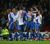 Fotball<br /> Premier League England 2004/2005<br /> Foto: SBI/Digitalsport<br /> NORWAY ONLY<br /> <br /> 30.10.2004<br /> Blackburn Rovers v Liverpool<br /> <br /> Blackburn's Brett Emerton (1 from R) is mobbed by his team-mates after he scores Blackburn's second goal to put them into the lead.